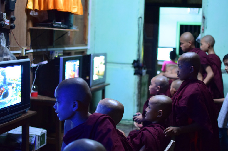 Young Monks playing computer games | Burma